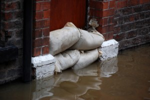 Flood damage - water seeping through flood defences