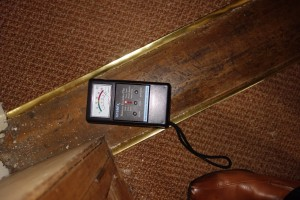 assessing water damage with a moisture meter
