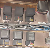 Fire Damage Claim - charred electric meters damaged by smoke and fire