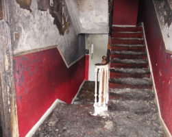Fire damage claim - the staircase of a Georgian apartment building damaged by fire