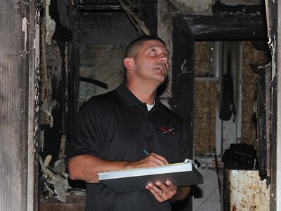 Loss assessor assessing damage to property damaged by fire