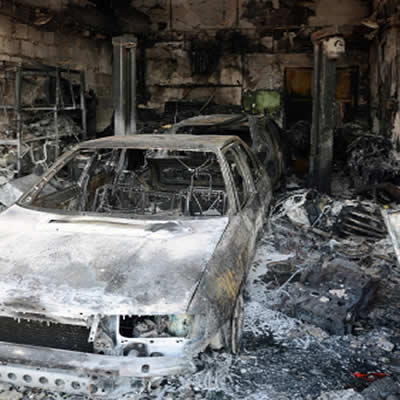 burnt cars and equipment in car service